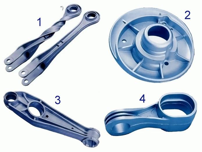 Bild 4: Gussteile, hergestellt mit dem Vacural-Verfahren, Quelle: Ritter Aluminium GmbH 1) Längslenker PKW-Achse, 0,45 kg, *) Rissfreiheit bei einem um 360° verdrehten Teil 2) Außenflansch für PKW-Stoßdämpfer, 0,64 kg 3) Querlenker für PKW-Hinter- und Vorderachse, 0,74 kg 4) Konsole für Aggregatlagerung, 0,71 kg