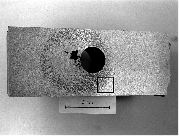 Fig. 1: Cutting surface of a casting with chunky graphite areas, that can be clearly distinguished as dark spots, even with the unaided eye.