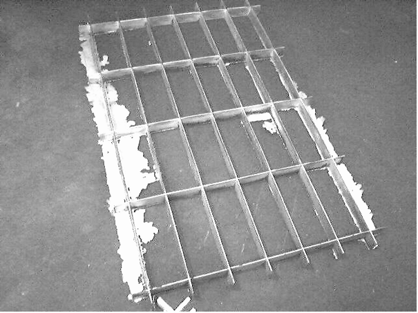 Fig. 1: Formation of burrs in a cast aluminum grille (dimensions 2 m x 3 m)