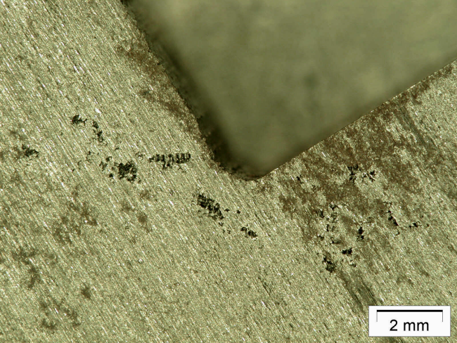 "Fig. 1: Microporosity as a consequence of the ""sand edge effect"", here in cast iron with flake graphite"