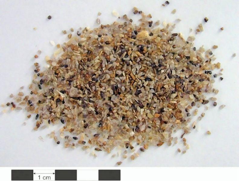 Fig. 1: Zirconium silicate (dark-brown crystals) as the basic raw material of zircon sand, Wilberforce deposit, Ontario, Canada, source: Verein zur Verbreitung naturwissenschaftlicher Kenntnisse, University of Vienna