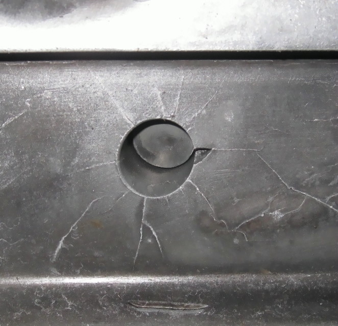 Fig. 5:  Stress cracks around ejector bore at a die casting tool with break, 120,000 fillings, material 1.2343, source: FT&E Foundry Technologies & Engineering GmbH