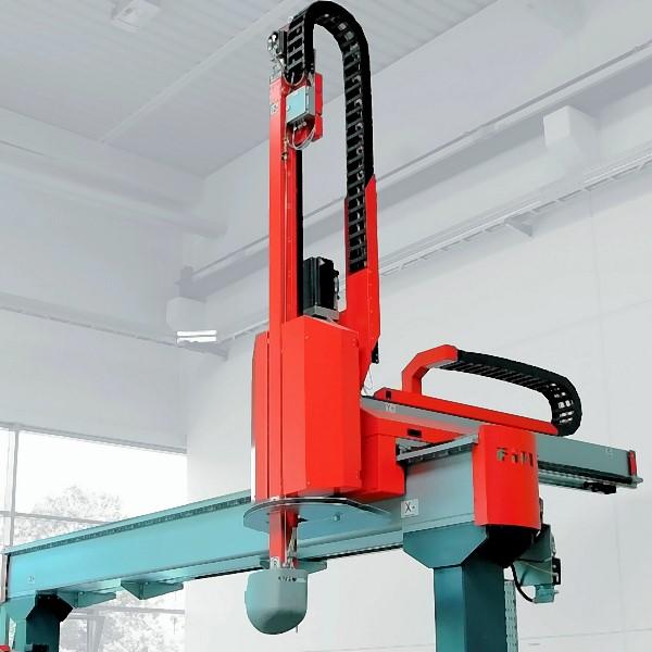 Bild 1: Gießmanipulator mit montiertem Gießlöffel, Type CASTMASTER der Fa. Fill GmbH