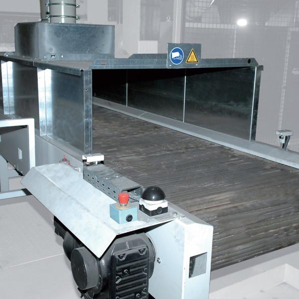 Bild 3: Stabförderer COOlVEYOR STICKS von Fa. Fill GmbH in Verwendung zum Teiletransport als Pufferförderer oder als Kühlstrecke für Gussteile. Beschickung und Entnahme erfolgen wahlweise manuell oder automatisch