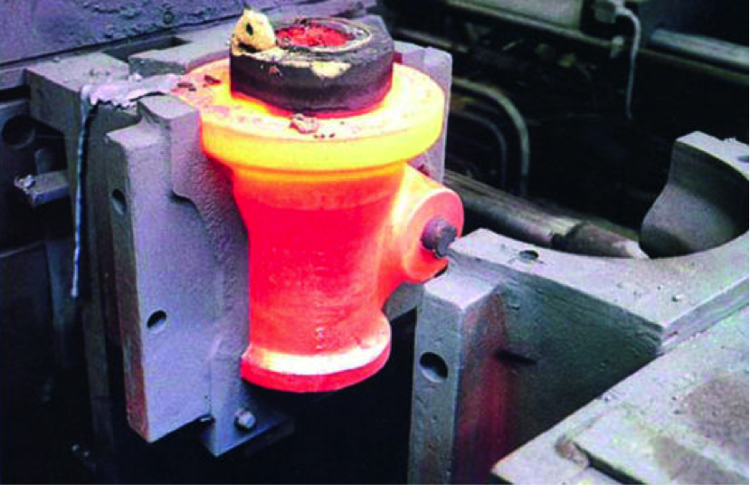 Fig. 1: Two-part mold in the raised state with red-hot, but already design-resistant casting (Source: Rexroth Guss, Lohr),